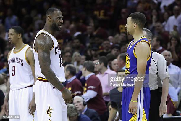 LeBron James of the Cleveland Cavaliers and Stephen Curry of the Golden State Warriors exchange words during a time out during the fourth quarter in...