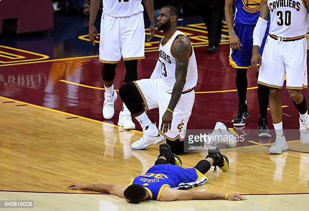 LeBron James of the Cleveland Cavaliers and Stephen Curry of the Golden State Warriors react during the first half in Game 6 of the 2016 NBA Finals...