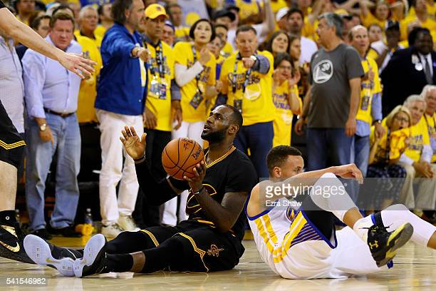 LeBron James of the Cleveland Cavaliers and Stephen Curry of the Golden State Warriors sit on the court after a play in Game 7 of the 2016 NBA Finals...