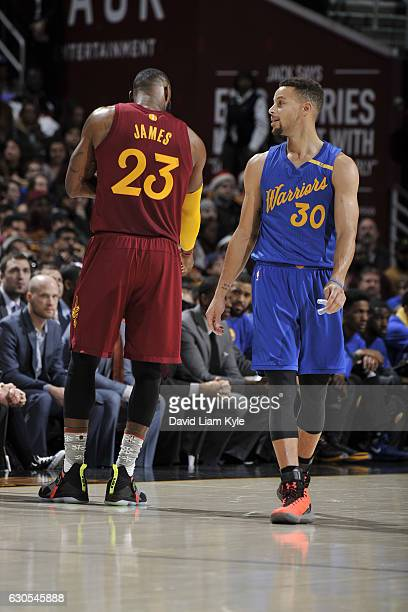 LeBron James of the Cleveland Cavaliers and Stephen Curry of the Golden State Warriors on December 25 2016 at Quicken Loans Arena in Cleveland Ohio...