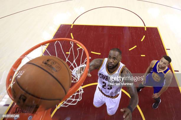 LeBron James of the Cleveland Cavaliers and Stephen Curry of the Golden State Warriors await a rebound in the first half in Game 3 of the 2017 NBA...