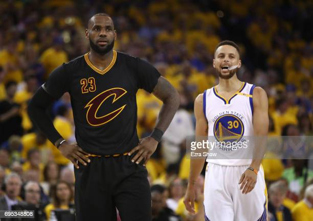 LeBron James of the Cleveland Cavaliers and Stephen Curry of the Golden State Warriors look on during the first half in Game 5 of the 2017 NBA Finals...