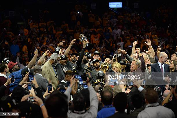 LeBron James of the Cleveland Cavaliers and teammates celebrate with the Larry O'Brien NBA Championship Trophy after defeating the Golden State...