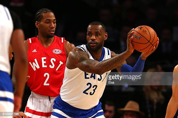 LeBron James of the Cleveland Cavaliers and the Eastern Conference handles the ball against Kawhi Leonard of the San Antonio Spurs and the Western...
