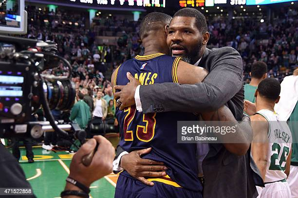 LeBron James of the Cleveland Cavaliers and Walter McCarty of the Boston Celtics hug after Game Four of the Eastern Conference Quarterfinals during...