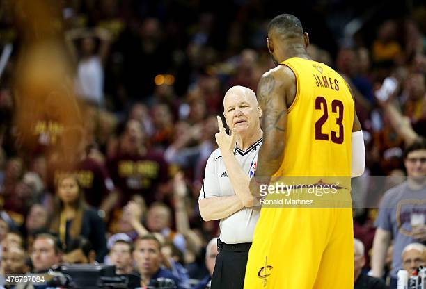 LeBron James of the Cleveland Cavaliers argues a call with referee Joe Crawford in the first quarter against the Golden State Warriors during Game...