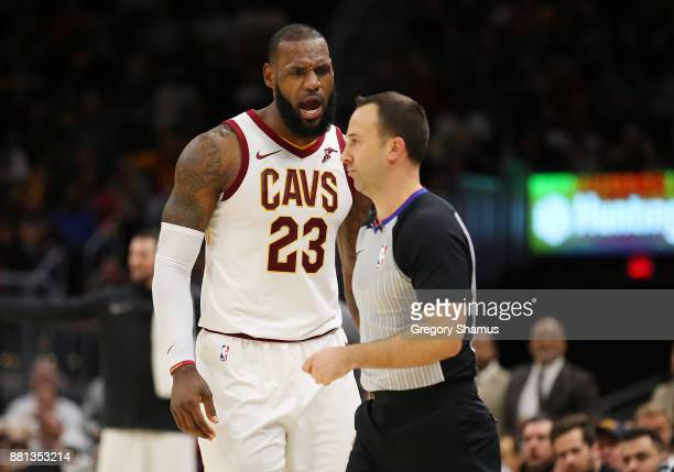 LeBron James of the Cleveland Cavaliers argues after being ejected in the second half by referee Kane Fitzgerald while playing the Miami Heat at...
