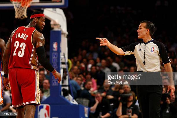 LeBron James of the Cleveland Cavaliers argues an offensive foul call with the referee against the New York Knicks at Madison Square Garden November...