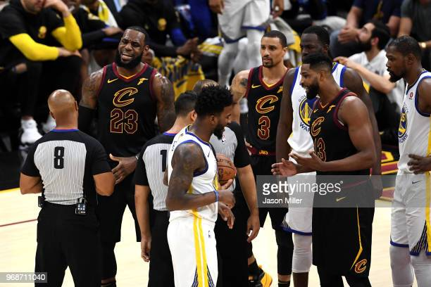 LeBron James of the Cleveland Cavaliers argues with referee Marc Davis against the Golden State Warriors in the first half during Game Three of the...