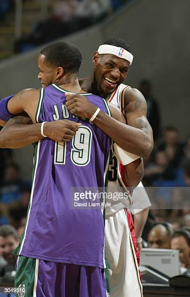 LeBron James of the Cleveland Cavaliers at the start of the game hugs Damon Jones of the Milwaukee Bucks at Gund Arena on March 6 2004 in Cleveland...