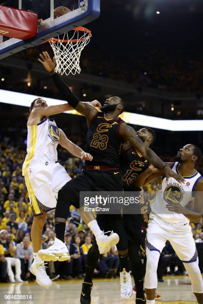LeBron James of the Cleveland Cavaliers attempts a layup against Klay Thompson of the Golden State Warriors during the first half in Game 1 of the...