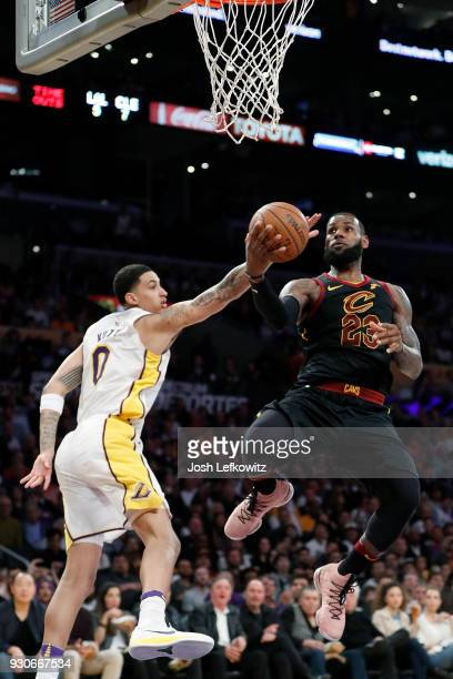 LeBron James of the Cleveland Cavaliers attempts a layup agaist Kyle Kuzma of the Los Angeles Lakers during the second quarter of the game at Staples...