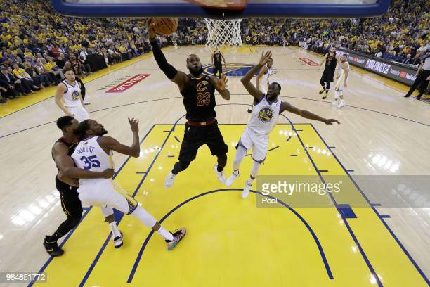 LeBron James of the Cleveland Cavaliers attempts a layup over Draymond Green of the Golden State Warriors in Game 1 of the 2018 NBA Finals at ORACLE...