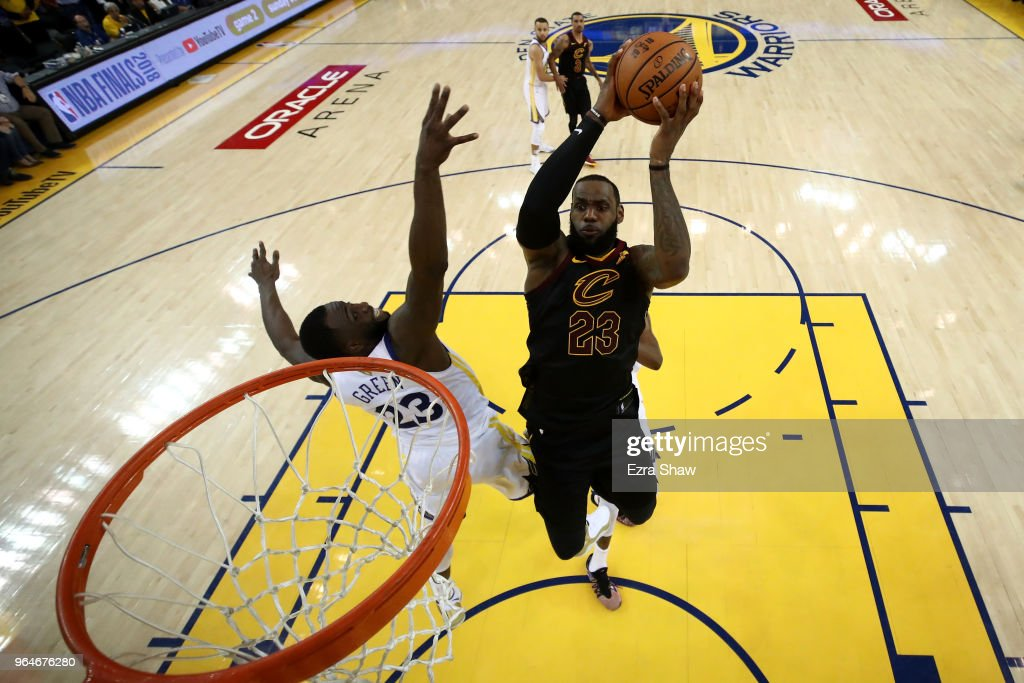 LeBron James #23 of the Cleveland Cavaliers attempts a layup over Draymond Green #23 of the Golden State Warriors in Game 1 of the 2018 NBA Finals at ORACLE Arena on May 31, 2018 in Oakland, California.