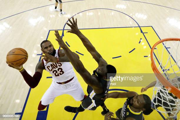 LeBron James of the Cleveland Cavaliers attempts a layup over Draymond Green of the Golden State Warriors in Game 2 of the 2018 NBA Finals at ORACLE...
