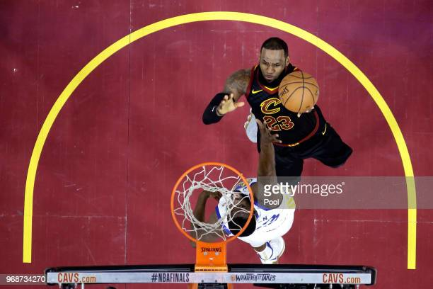 LeBron James of the Cleveland Cavaliers attempts a layup over Draymond Green of the Golden State Warriors in the first half during Game Three of the...
