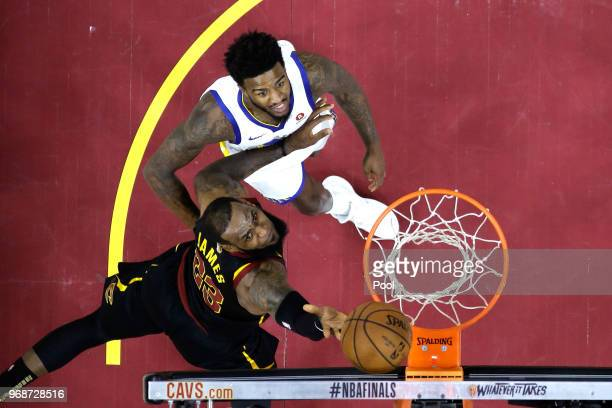 LeBron James of the Cleveland Cavaliers attempts a layup over Jordan Bell of the Golden State Warriors in the first half during Game Three of the...
