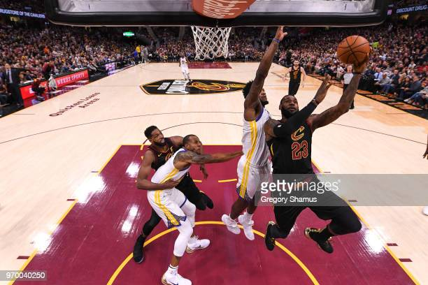 LeBron James of the Cleveland Cavaliers attempts a layup over Jordan Bell of the Golden State Warriors in the first half during Game Four of the 2018...