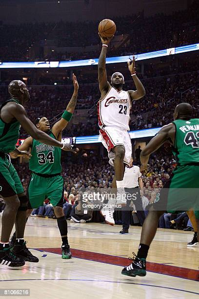 LeBron James of the Cleveland Cavaliers attempts a shot against Kevin Garnett , Paul Pierce and Kendrick Perkins of the Boston Celtics in Game Four...