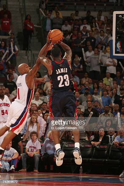 LeBron James of the Cleveland Cavaliers attempts a shot against Chauncey Billups of the Detroit Pistons in Game Five of the Eastern Conference Finals...