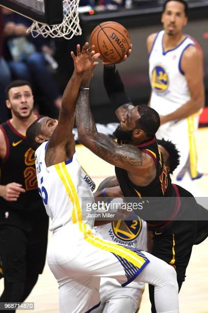 LeBron James of the Cleveland Cavaliers attempts a shot defended by Kevin Durant of the Golden State Warriors in the first half during Game Three of...