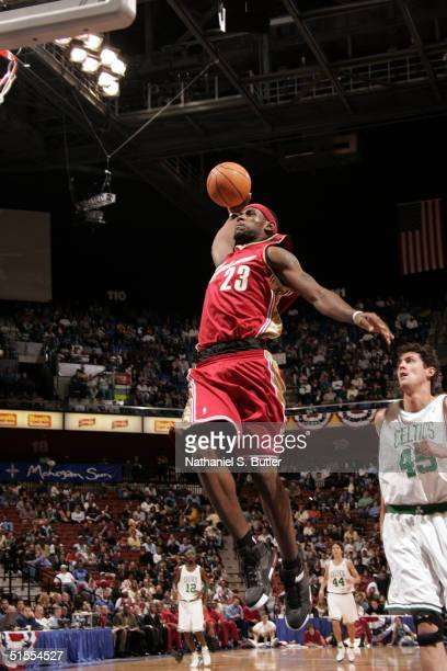 Lebron James of the Cleveland Cavaliers attempts dunk against Raef LaFrentz of the Boston Celtics during pre-season October 23, 2004 at the Mohegan...