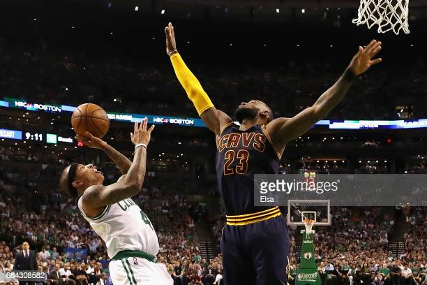 LeBron James of the Cleveland Cavaliers attempts to block a shot by Isaiah Thomas of the Boston Celtics in the first half during Game One of the 2017...