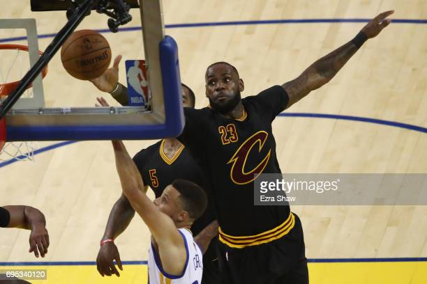 LeBron James of the Cleveland Cavaliers attempts to block a shot from Stephen Curry of the Golden State Warriors during the first half in Game 5 of...