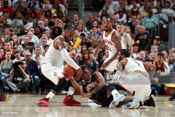 LeBron James of the Cleveland Cavaliers attempts to steal the ball from Lavoy Allen of the Indiana Pacers in Round One of the Eastern Conference...