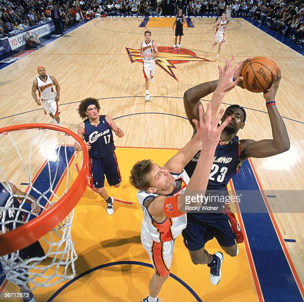 LeBron James of the Cleveland Cavaliers battles for a shot against Andris Biedrins of the Golden State Warriors during a game at The Arena in Oakland...