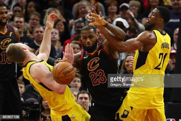 LeBron James of the Cleveland Cavaliers battles for the ball with Thaddeus Young and Domantas Sabonis of the Indiana Pacers during the second half of...