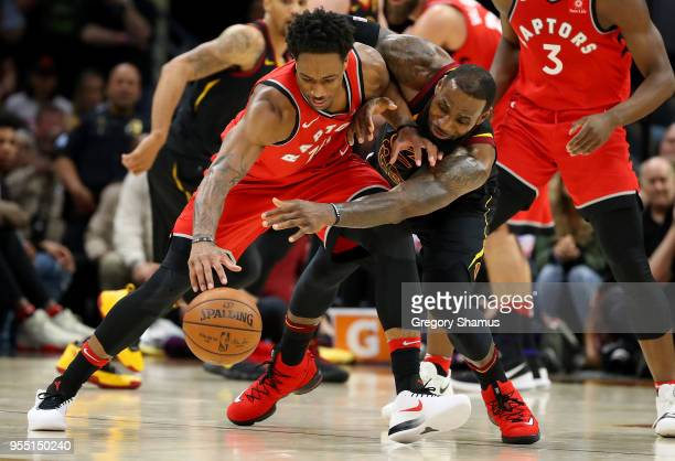 LeBron James of the Cleveland Cavaliers battles with DeMar DeRozan of the Toronto Raptors during the second half in Game Three of the Eastern...