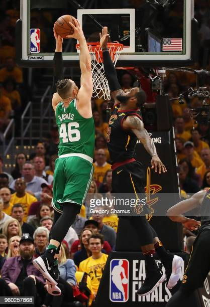 LeBron James of the Cleveland Cavaliers blocks a dunk by Aron Baynes of the Boston Celtics in the first half during Game Three of the 2018 NBA...