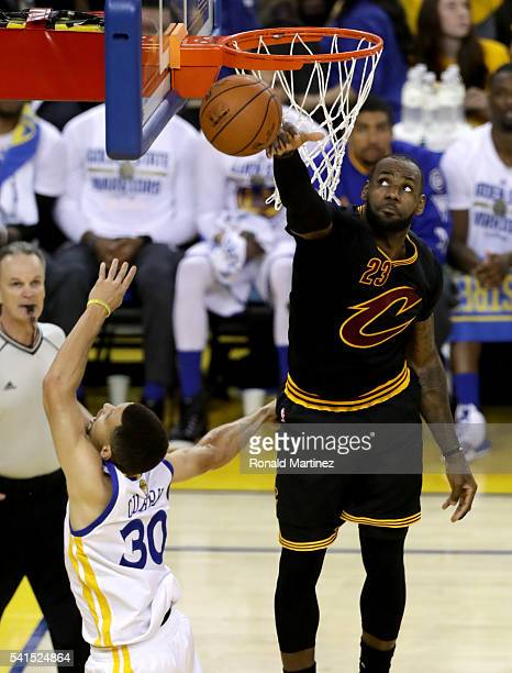 LeBron James of the Cleveland Cavaliers blocks a shot by Stephen Curry of the Golden State Warriors in Game 7 of the 2016 NBA Finals at ORACLE Arena...