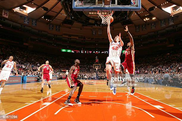 LeBron James of the Cleveland Cavaliers blocks against David Lee of the New York Knicks on November 6, 2009 at Madison Square Garden in New York...