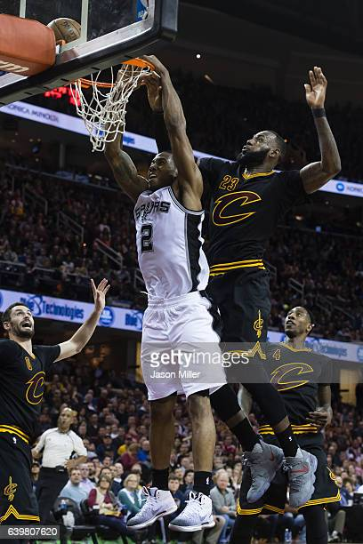 LeBron James of the Cleveland Cavaliers blocks Kawhi Leonard of the San Antonio Spurs during overtime at Quicken Loans Arena on January 21 2017 in...