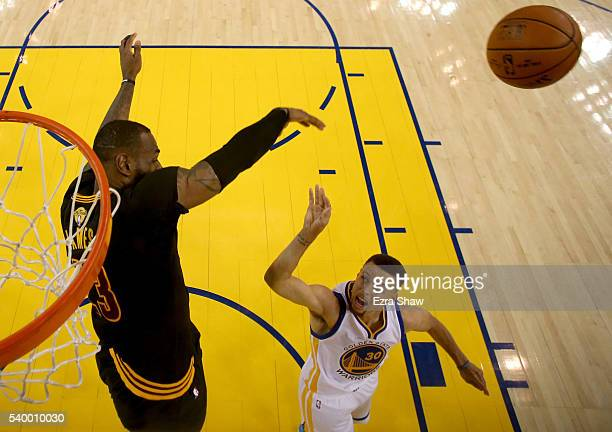 LeBron James of the Cleveland Cavaliers blocks the shot of Stephen Curry of the Golden State Warriors in the first half in Game 5 of the 2016 NBA...