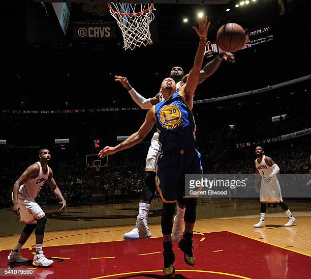 LeBron James of the Cleveland Cavaliers blocks the shot of Stephen Curry of the Golden State Warriors in Game Six of the 2015 NBA Finals on June 16...