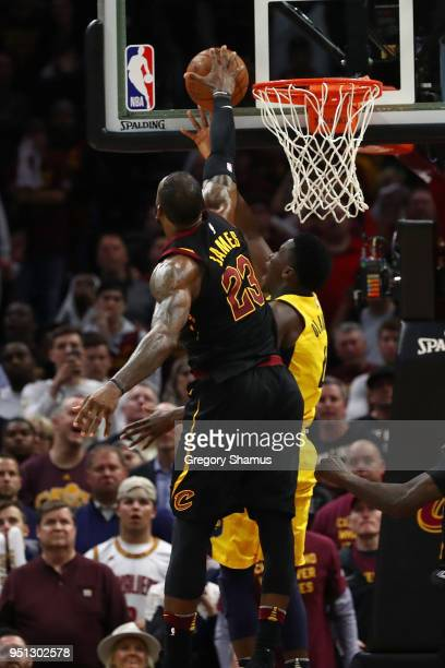 LeBron James of the Cleveland Cavaliers blocks the shot of Victor Oladipo of the Indiana Pacers late Game Five of the Eastern Conference...
