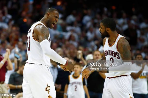 LeBron James of the Cleveland Cavaliers celebrates a second half dunk with Kyrie Irving while playing the Indiana Pacers in Game One of the Eastern...
