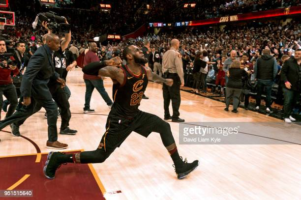 LeBron James of the Cleveland Cavaliers celebrates after hitting the game winner against the Indiana Pacers in Game Five of Round One of the 2018 NBA...
