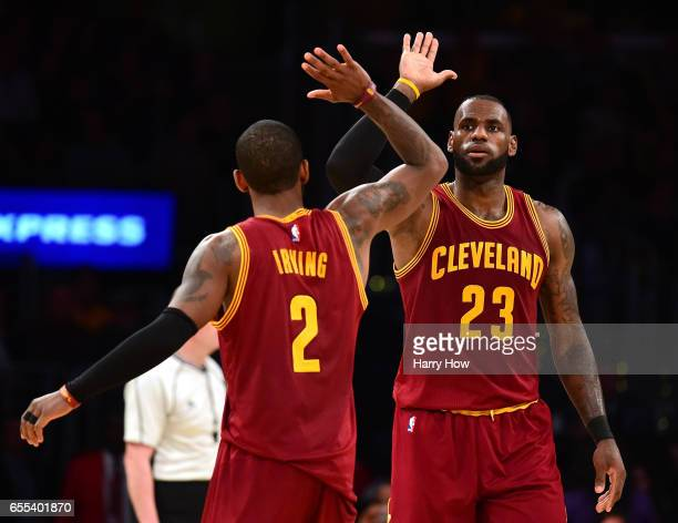 LeBron James of the Cleveland Cavaliers celebrates his basket with a foul with Kyrie Irving during a 125120 win over the Los Angeles Lakers at...