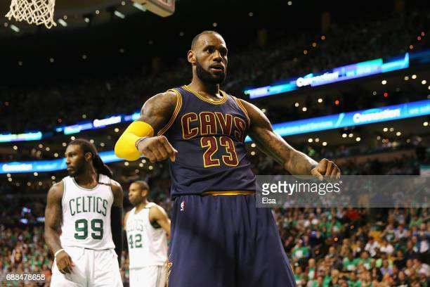 LeBron James of the Cleveland Cavaliers celebrates his dunk in the third quarter as Jae Crowder of the Boston Celtics looks on during Game Five of...