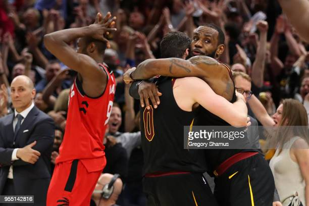 LeBron James of the Cleveland Cavaliers celebrates his game winning shot with Kevin Love next to Serge Ibaka of the Toronto Raptors during Game Three...
