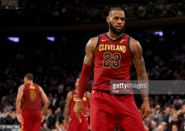LeBron James of the Cleveland Cavaliers celebrates his three point shot to give the Cleveland Cavaliers the lead over the New York Knicks in the...