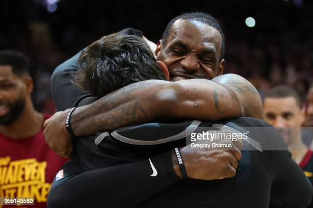 LeBron James of the Cleveland Cavaliers celebrates with Cedi Osman after hitting the game winning shot to beat the Toronto Raptors 105103 in Game...