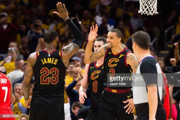 LeBron James of the Cleveland Cavaliers celebrates with George Hill after Hill scored during the second half of Game 4 of the second round of the...