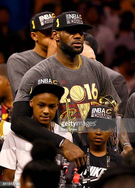 LeBron James of the Cleveland Cavaliers celebrates with his sons LeBron Jr and Bryce after defeating the Golden State Warriors 9389 in Game 7 of the...