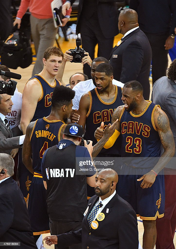 LeBron James #23 of the Cleveland Cavaliers celebrates with Iman Shumpert #4 after defeating the Golden State Warriors in Game Two of the 2015 NBA Finals on June 7, 2015 at Oracle Arena in Oakland, California. Cavaliers won 95-93.