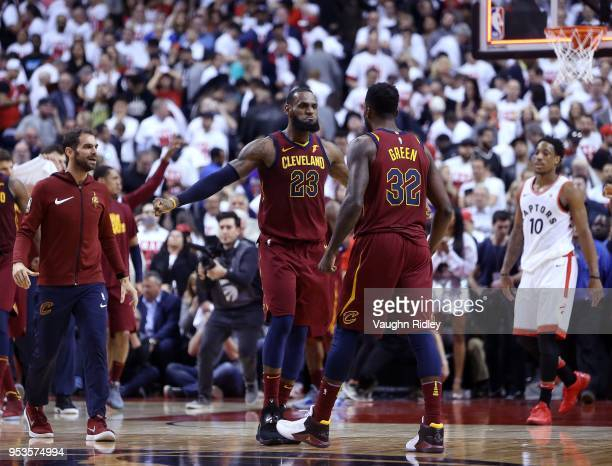 LeBron James of the Cleveland Cavaliers celebrates with Jeff Green in overtime in Game One of the Eastern Conference Semifinals against the Toronto...